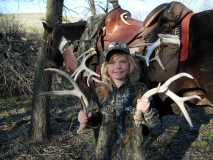 SHA48, Katelyn, the author's daughter admires shed antlers on a combo hunt for horns and hair, copyright Mark Kayser