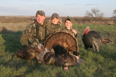 TH1007, Mark, Katelyn and Cole Kayser with Cole's first gobbler, copyright Mark Kayser