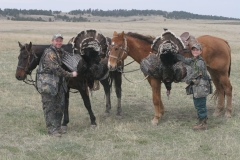 TH1018, Mark and Cole Kayser with Merriam's gobblers taken on horseback hunt, copyright Mark Kayser