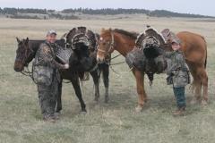 TH1018, Mark and Cole Kayser with Merriam's gobblers taken on horseback hunt, copyright Mark Kayser