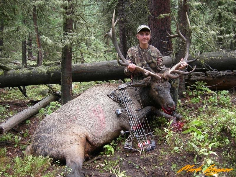 BE487, Cole Kayser with 2013 Wyoming bull elk, copyright Mark Kayser