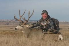 BMB36, Mark Kayser with bowkilled mule deer in South Dakota, copyright Mark Kayser #2