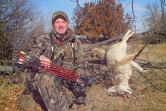 CH428, Mark Kayser with a bowkilled coyote, copyright Mark Kayser