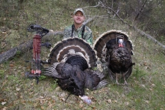 TH1176, Mark Kayser with a Merriam's turkey he shot from a blind set in the preseason, copyright Mark Kayser edt